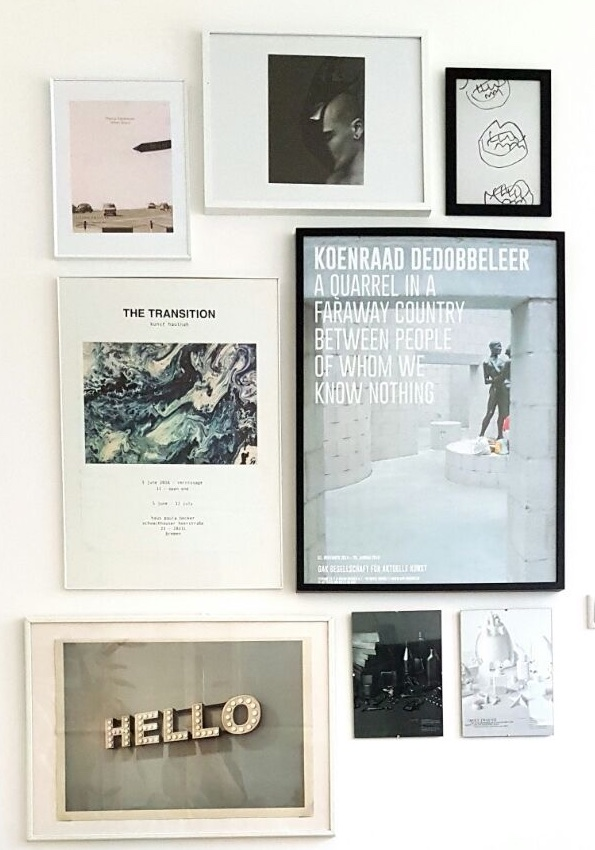 Art posters in black and white frames building a gallery wall.