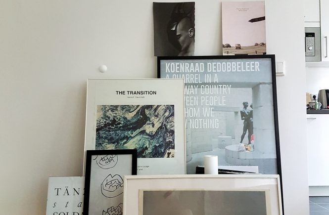 Art posters and photographs in different frames.