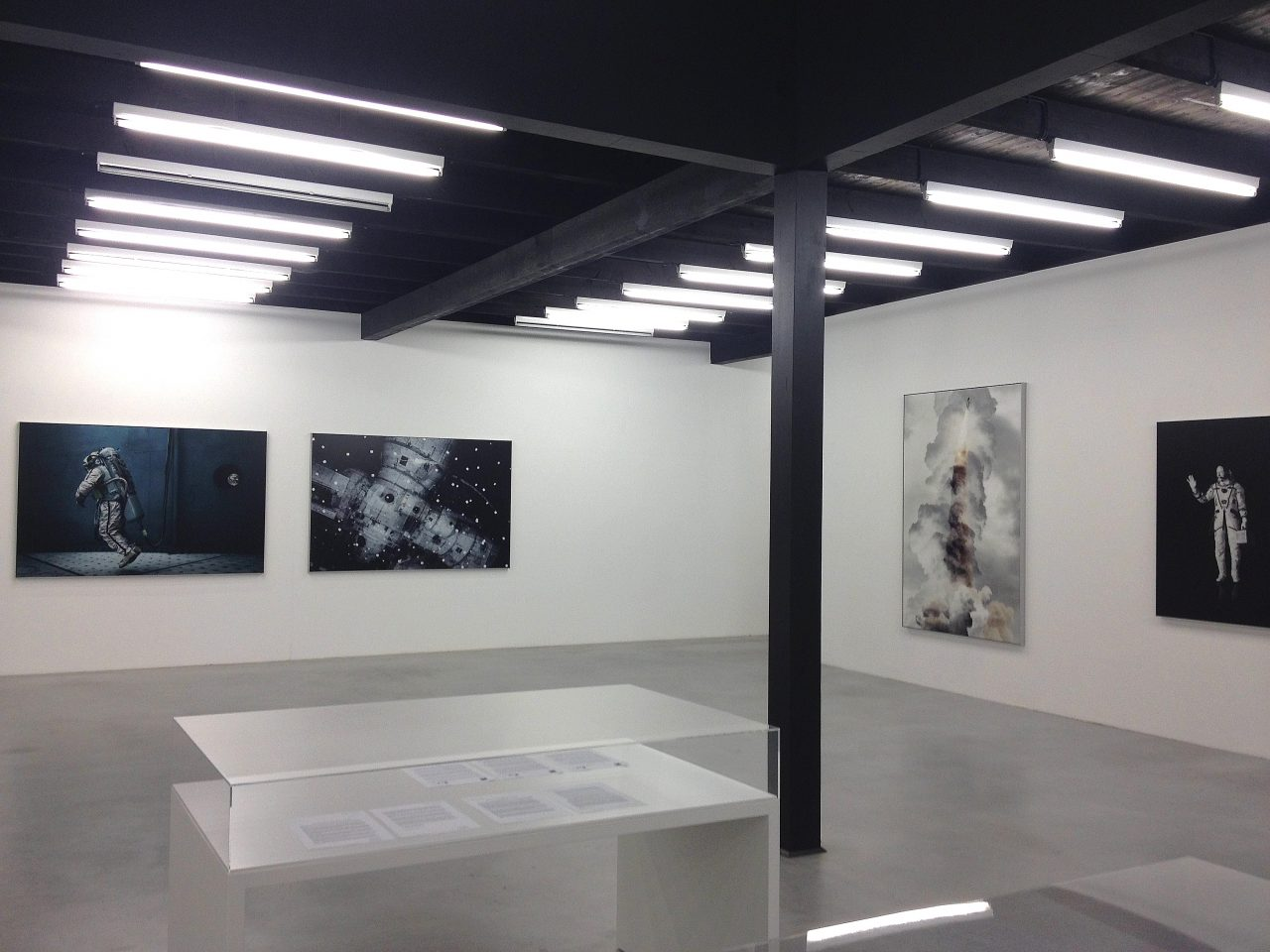 "Main hall of the ""Outer Space"" exhibition by Michael Najjar with several spaced themed pictures at Kunstverein Oldenburg"